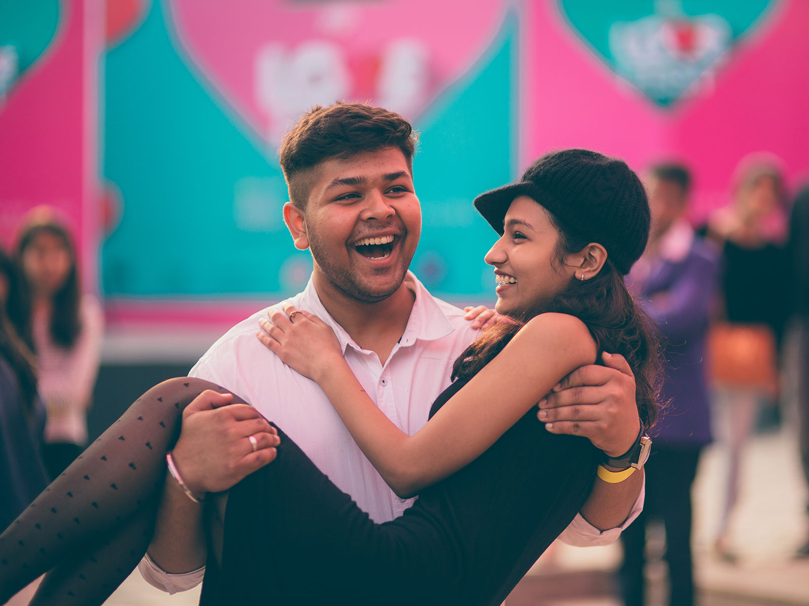 A couple gets candid at the POPxo Love Fest held at One Golden Mile in Delhi